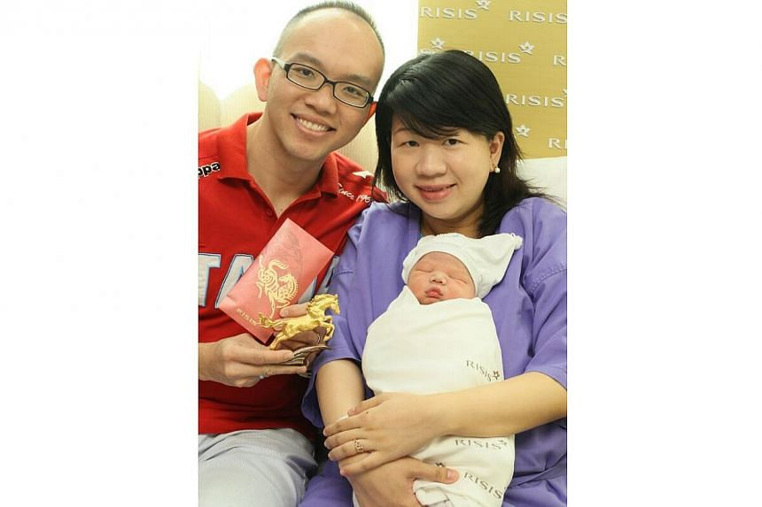 Mr Gan Thong Hoe, Ms Yao Yi Zhen and their son Keefe Gan. -- PHOTO: SHIN MIN