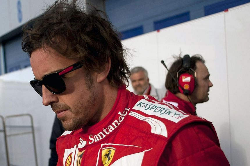 Ferrari Spanish driver Fernando Alonso walks during a testing session at Jerez racetrack, on Jan 30, 2014, in Jerez. Alonso gave the home fans something to cheer about on Friday, Jan 31, 2014, as he was fastest on the fourth and final morning of pre-