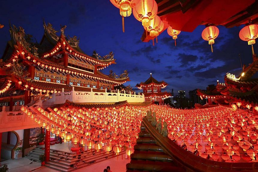 Lanterns are hung in a Chinese temple ahead of Chinese New Year celebrations in Kuala Lumpur, on Jan 30, 2014. -- PHOTO: REUTERS