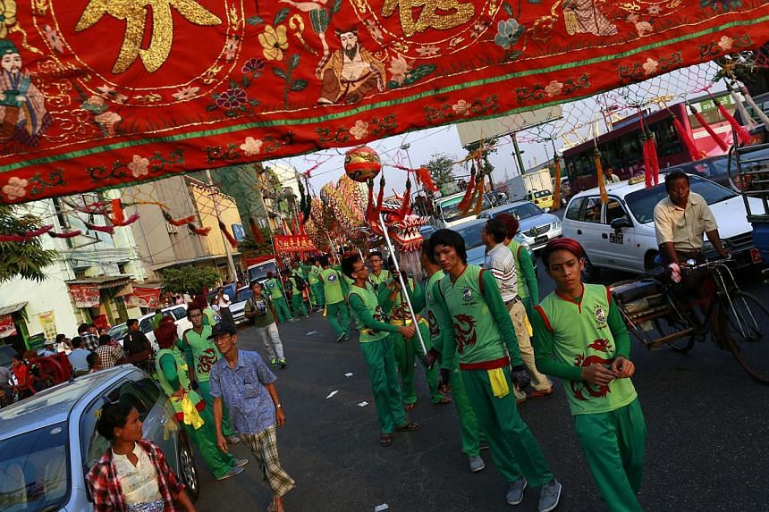 People celebrate ahead of Chinese New Year in Yangon's Chinatown, on Jan 30, 2014. -- PHOTO: REUTERS