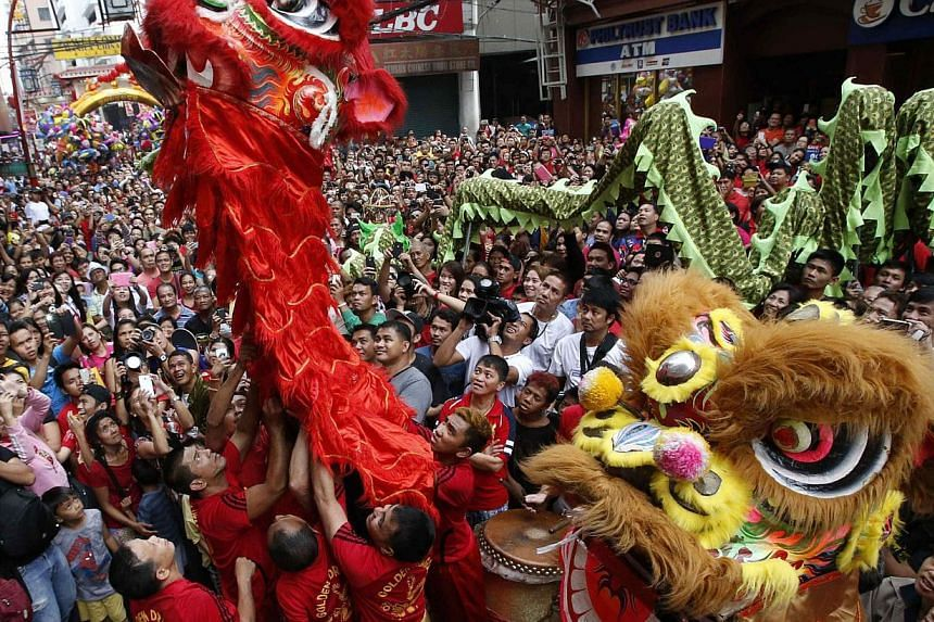 Residents take part in the Chinese New Year celebration in Manila's Chinatown, on Jan 31, 2014. -- PHOTO: REUTERS