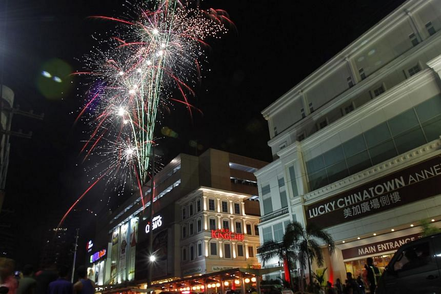 A fireworks display lights up a mall during a Chinese New Year celebration at Chinatown in Manila, on Jan 31, 2014. -- PHOTO: REUTERS