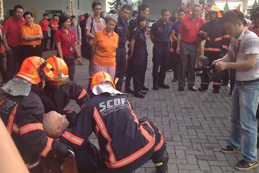 PM Lee Hsien Loong watches drills conducted by the Singapore Civil Defence Force personnel. -- ST PHOTO: GOH CHIN LIAN