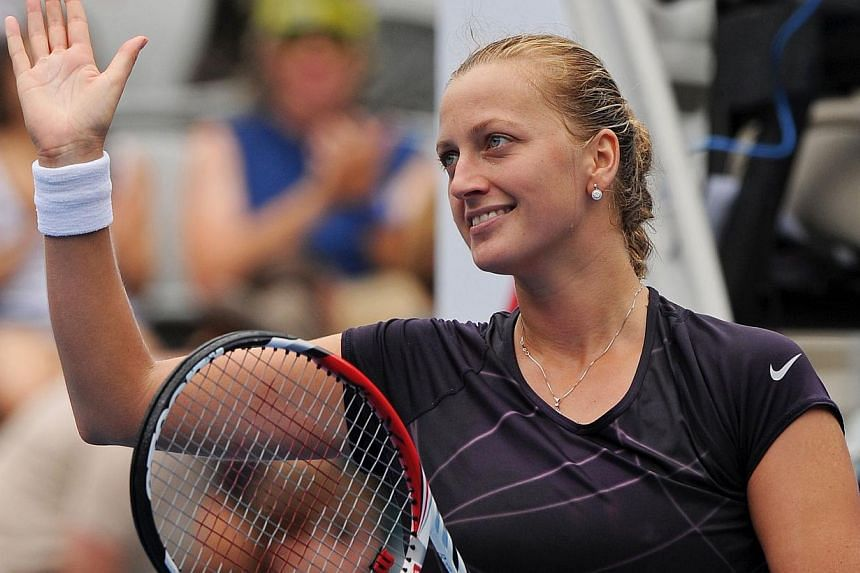 Petra Kvitova of the Czech Republic celebrates after defeating compatriot Lucie Safarova in their singles match at the APIA Sydney International tennis tournament on Jan 8, 2014. Second seed Kvitova pulled out of the Paris WTA Open on Jan 30, 2014, c