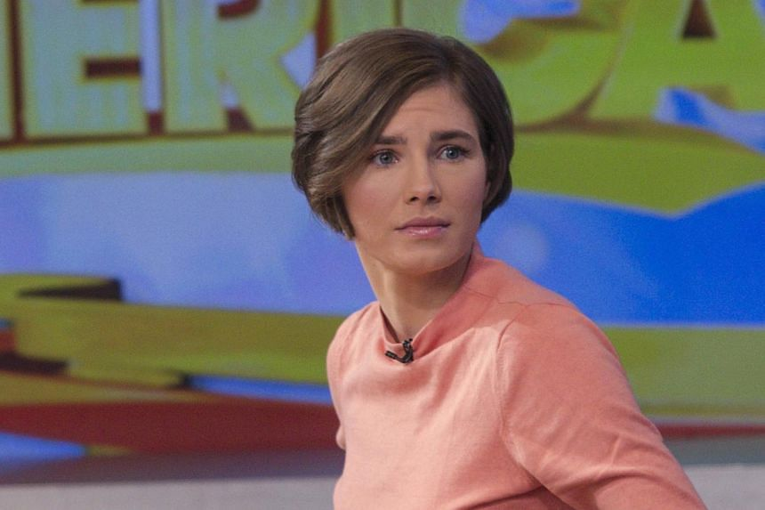 Amanda Knox reacts while being interviewed on the set of ABC's Good Morning America in New York on Jan 31, 2014. Italy's conviction of Knox for the murder of her British roommate when the two were exchange students together could spur a drawn-out fig