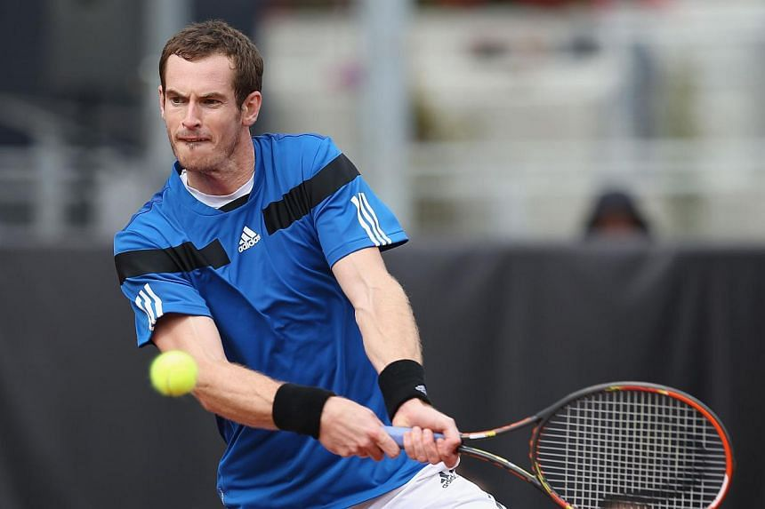 Andy Murray of Great Britain plays a backhand against Donald Young of the United States during day one of the Davis Cup World Group first round between the US and Great Britain at PETCO Park on Jan 31, 2014 in San Diego, California. Murray breezed pa