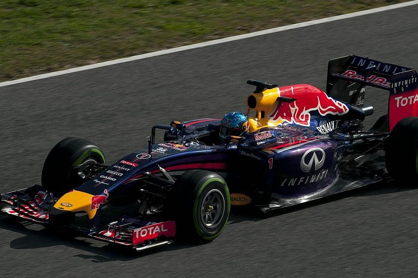 "Red Bull team's German driver Sebastian Vettel takes part in the Formula One pre-season test days at Jerez racetrack in Jerez on Jan 29, 2014. Renault recognised they faced a ""litany of issues"" with their new Formula One engine on Friday after proble"