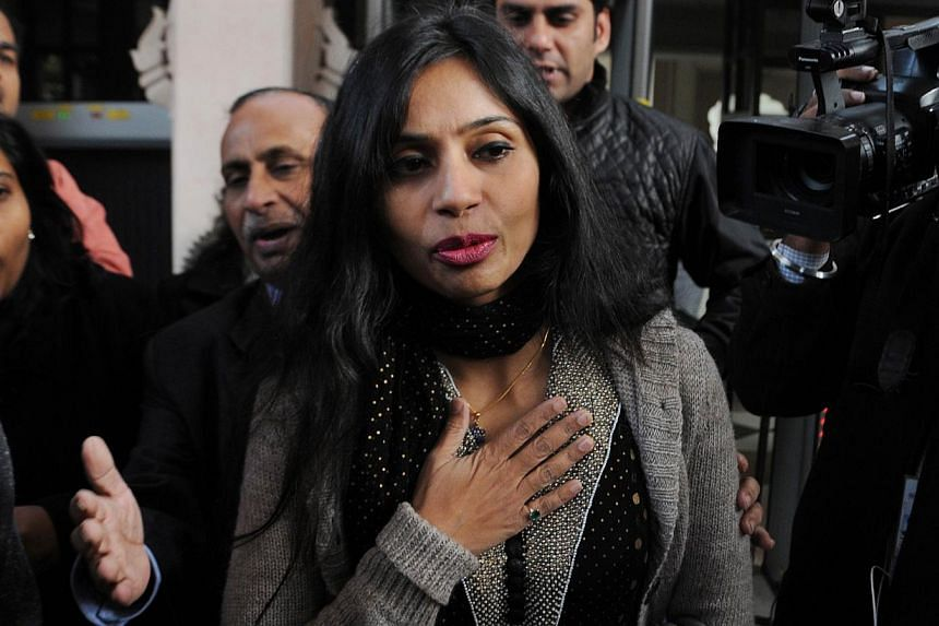 This file photo taken on Jan 11, 2014, shows Indian diplomat Devyani Khobragade (centre) leaving her guest house to meet with Indian Minister for External Affairs Salman Khurshid in New Delhi. Khobragade, whose December arrest led to a major internat