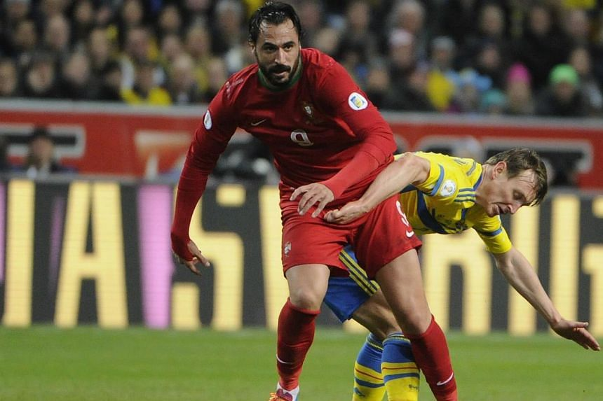 Portugal's Hugo Almeida (left) is chased by Sweden's Kim Kallstrom during the second leg of their 2014 World Cup qualifying soccer match at Friends Arena in Stockholm on Nov 19, 2013. Arsenal moved to bolster their depleted midfield by signing Kallst