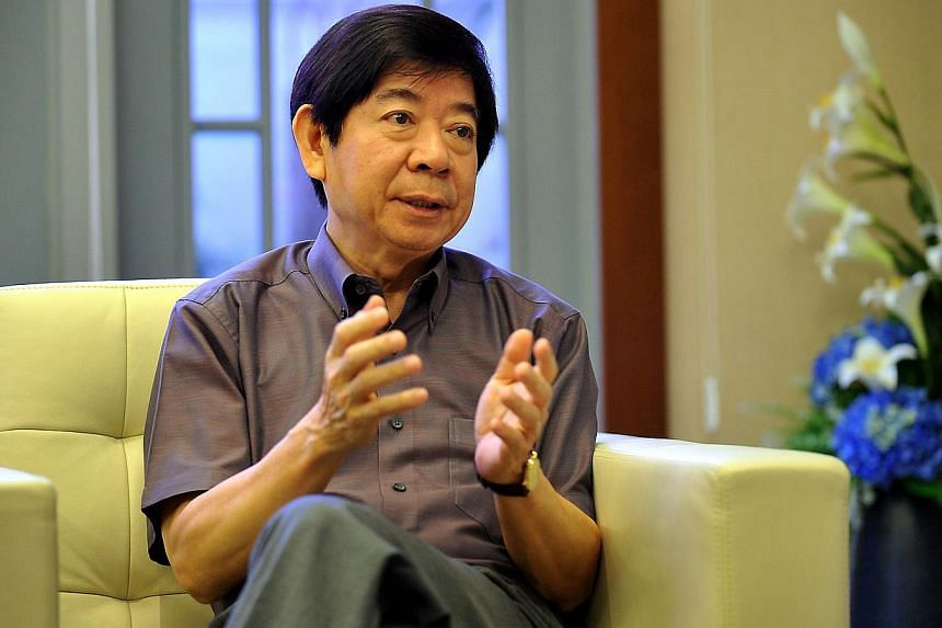 Mr Khaw Boon Wan during an interview on Nov 8, 2010. It is now easier for guide dogs to live in their owners' Housing Board flats, said Mr Khaw in a blog post on Saturday.-- ST FILE PHOTO: JOYCE FANG