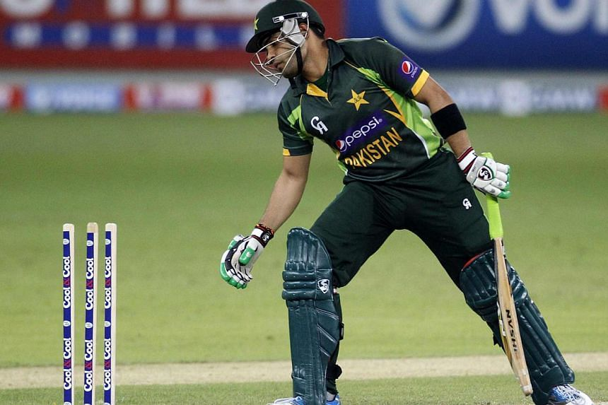 """Pakistan's middle-order cricket batsman Umar Akmal was arrested on Saturday, Feb 1, 2014, for violating traffic rules, interfering in government work and """"scuffling"""" with a traffic official. -- FILE PHOTO: REUTERS"""