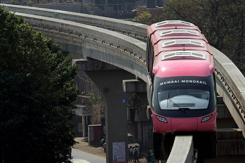 The Mumbai Monorail train makes its way through the city's eastern suburbs during a run between Wadala and Chembur in Mumbai, on Jan 29, 2014. India's financial capital unveiled its first monorail system on Saturday, Feb 1, 2014, a much-delayed proje
