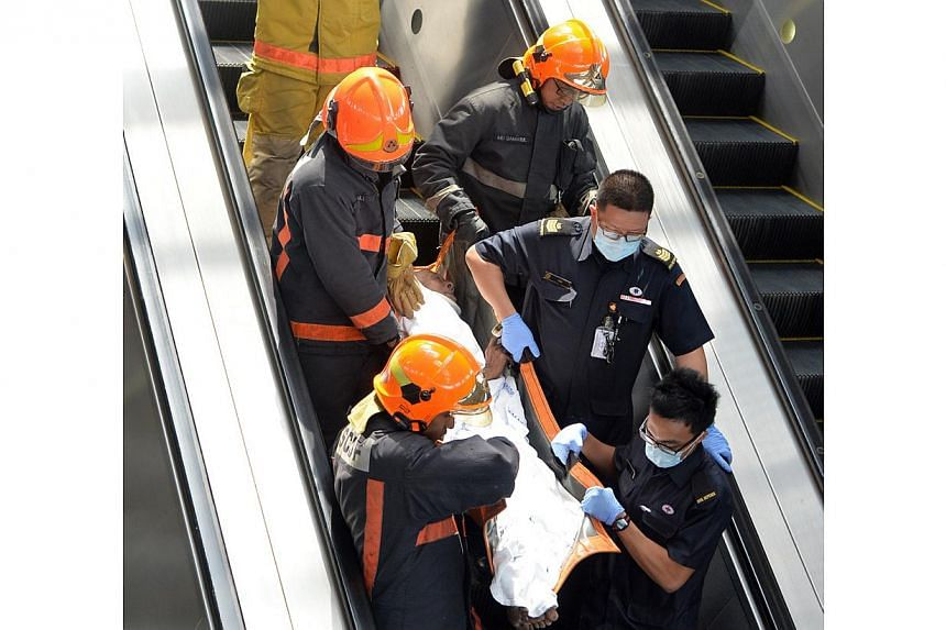 An old man in his 70s suffered lacerations after being involved in a MRT track accident. -- BH PHOTO: MOHD KHALID BABA