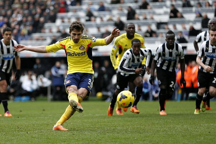 Sunderland's Fabio Borini (centre) scores a penalty against Newcastle United during their English Premier League soccer match at St James' Park in Newcastle, northern England, on Feb 1, 2014. Sunderland and West Ham United both climbed away from the