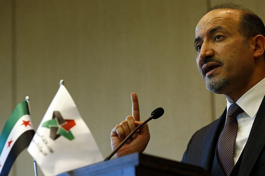 Syrian opposition leader Ahmad al-Jarba gestures as he makes a statement after the conclusion of talks on Syria, in Geneva, on Jan 31, 2014. Syrian government and opposition delegations leave ten days of peace talks with few results and a follow-up m