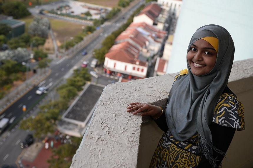 Ms Nisa Mohamed Maideen, 23, hopes the police presence will continue in her neighbourhood in Buffalo Road. -- ST PHOTO: MARK CHEONG