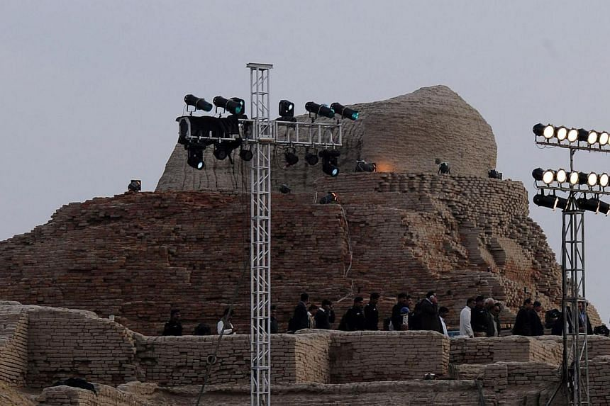 Pakistani security officials visit the ancient ruins of Moenjodaro, the Unesco World Heritage site around 425km north of the port city of Karachi on Feb 1, 2014. -- PHOTO: AFP