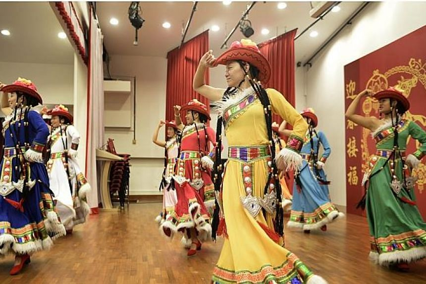 Dancers from Yunnan Opera Theatre perform at the Spring Reception 2014. -- ST PHOTO: MUGILAN RAJASEGERAN