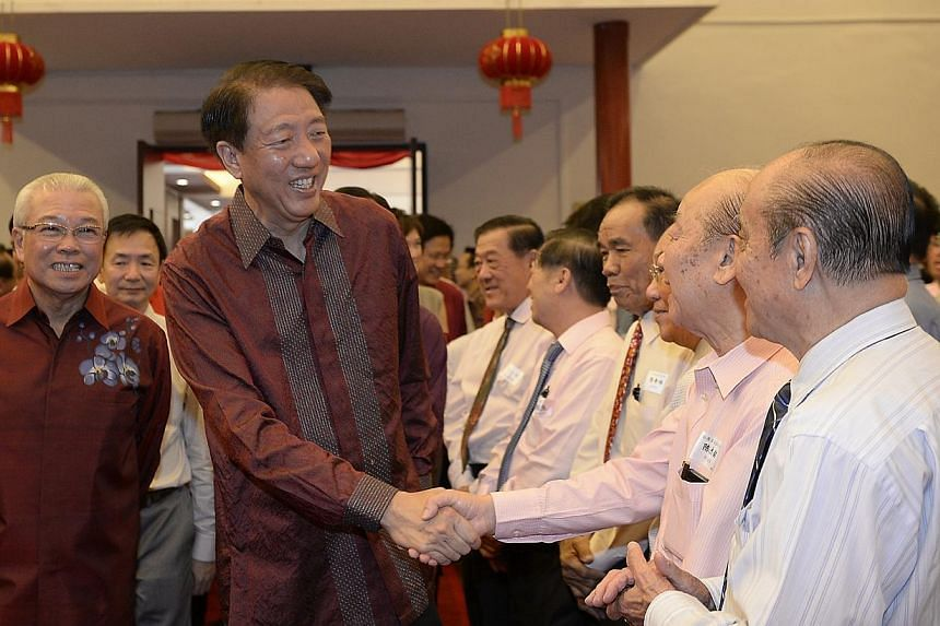 The guest-of-honour DPM Teo Chee Hean is greeted by event attendees. -- ST PHOTO:MUGILAN RAJASEGERAN