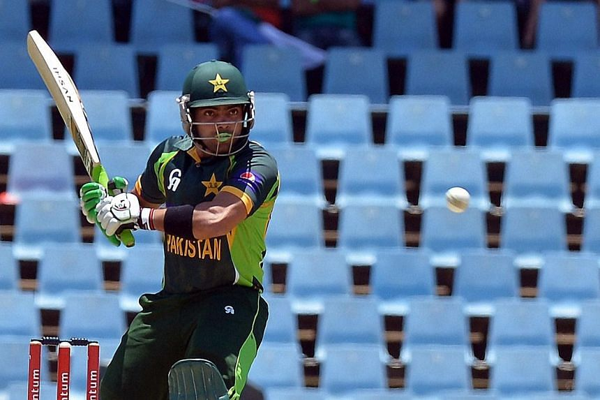 Pakistan's cricketer Umar Akmal avoids a bouncer from unseen South Africa's cricketer Imran Tahir during the final ODI between South Africa and Pakistan at SuperSport Park in Centurion, on Nov 30, 2013.Pakistan cricket star Umar Akmal was relea