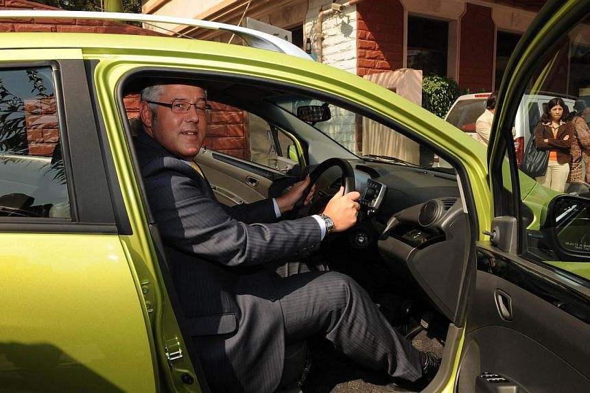 In this photograph taken on Jan 19, 2010, former Tata Motors managing director Karl Slym poses during the launch of a motor car in Ahmedabad. Tata Motors is launching two models this week for India's Auto Expo but the sudden death of its operati