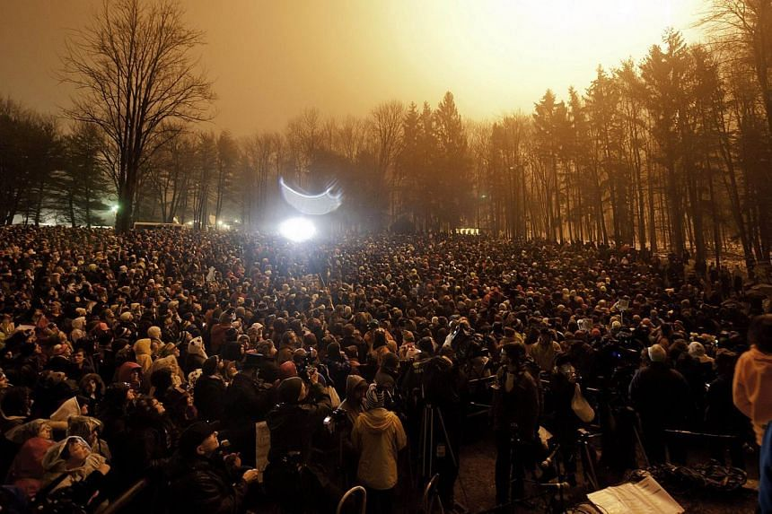 The crowd gathers during the Groundhog Day festivities where Punxsutawney Phil saw his shadow predicting six more weeks of winter during 128th annual Groundhog Day festivities on Feb 2, 2014 in Punxsutawney, Pennsylvania. -- PHOTO: AFP