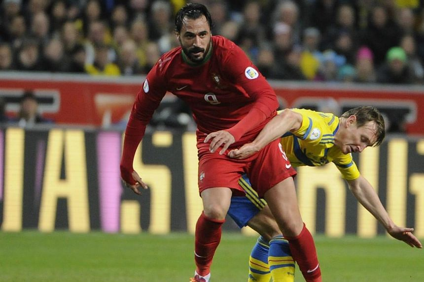 Portugal's Hugo Almeida (left) is chased by Sweden's Kim Kallstrom during the second leg of their 2014 World Cup qualifying soccer match at Friends Arena in Stockholm on Nov 19, 2013.Arsenal manager Arsene Wenger revealed on Sunday that new loa