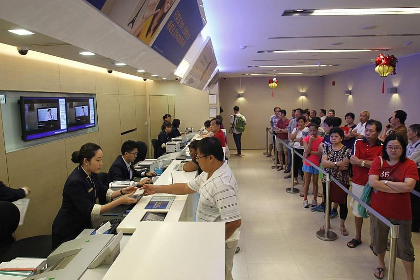 POSB branch at Ang Mo Kio Avenue 6 on Feb 2, 2014. POSB has rolled out new features at its branches to reduce queuing times for customers. -- ST PHOTO: KEVIN LIM