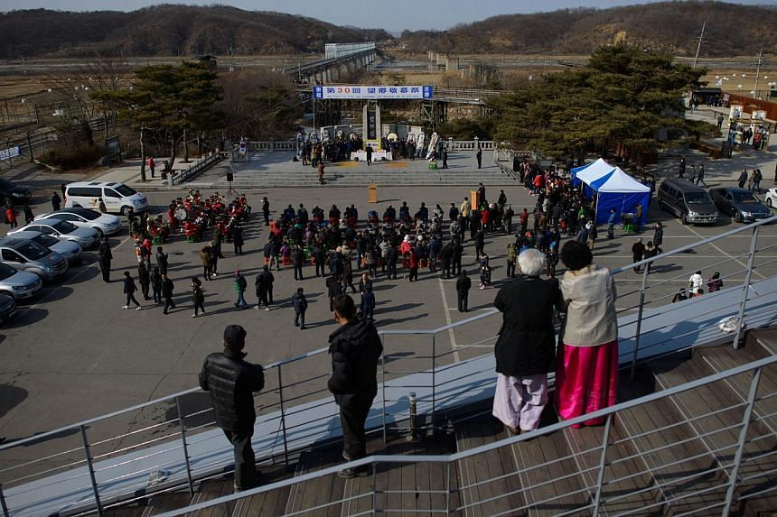 A general view shows a memorial service held by South Korea's Unification Ministry for families with relatives in North Korea, at the Demilitarized Zone (DMZ) at Imjingak, Paju, in South Korea's Gyeonggi Province on Jan 31, 2014. North Korea agreed o