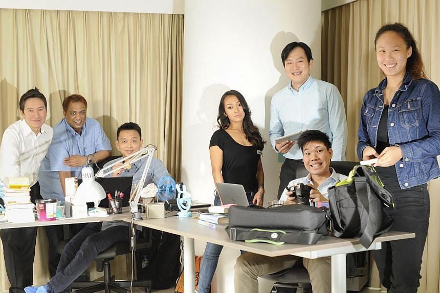 The Mothership.sg crew are (from left) executive director Lien We King, director Edwin Ramesh, editor Belmont Lay, administrative staff Tan Wei Fen, editors Martino Tan and Jonathan Lim, and intern Sally Ong.