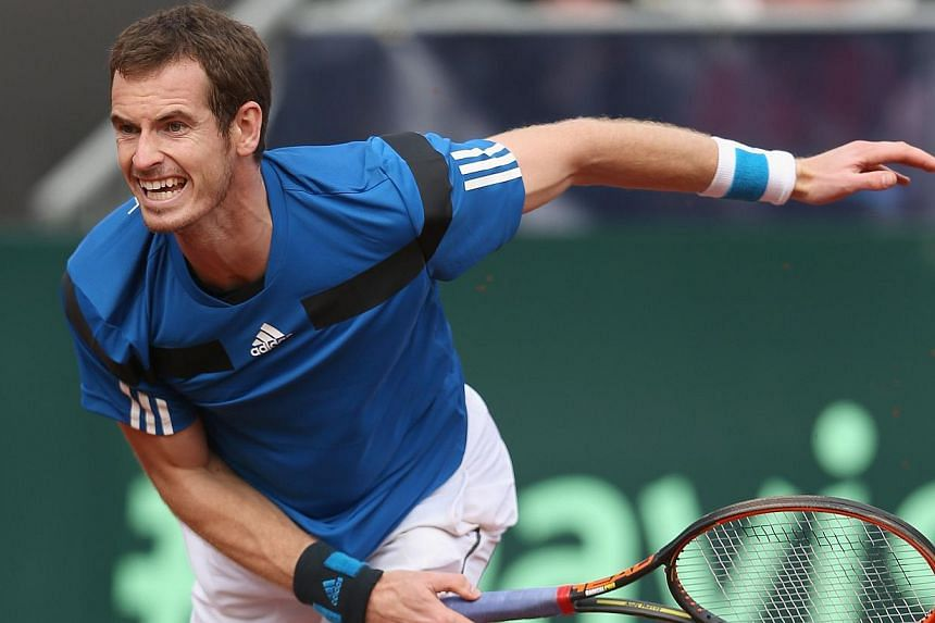 Andy Murray of Great Britain serves against Sam Querrey of the United States during day three of the Davis Cup World Group first round between the US and Great Britain at PETCO Park on Feb 2, 2014 in San Diego, California. Murray won in four sets on