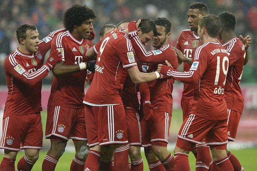 (From left) Bayern Munich's Swiss midfielder Xherdan Shaqiri, Brazilian defender Dante, Brazilian defender Rafinha, Croatian striker Mario Mandzukic, French midfielder Franck Ribery, Spanish midfielder Thiago Alcantara, defender Jerome Boateng, midfi