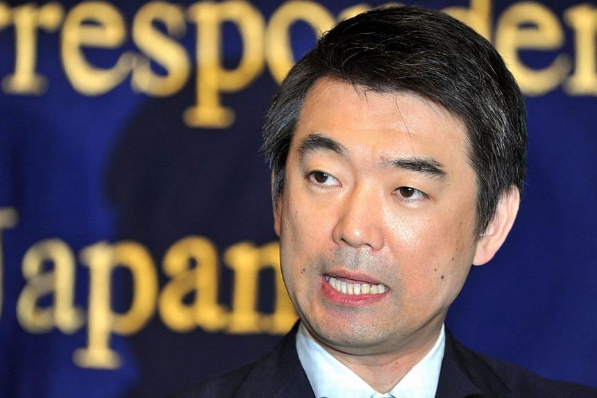 This file photo taken on May 27, 2013 shows Osaka Mayor Toru Hashimoto speaking during a press conference at the Foreign Correspondents' Club of Japan in Tokyo. The controversial mayor of Japan's second city, Osaka, is to step down and seek re-electi