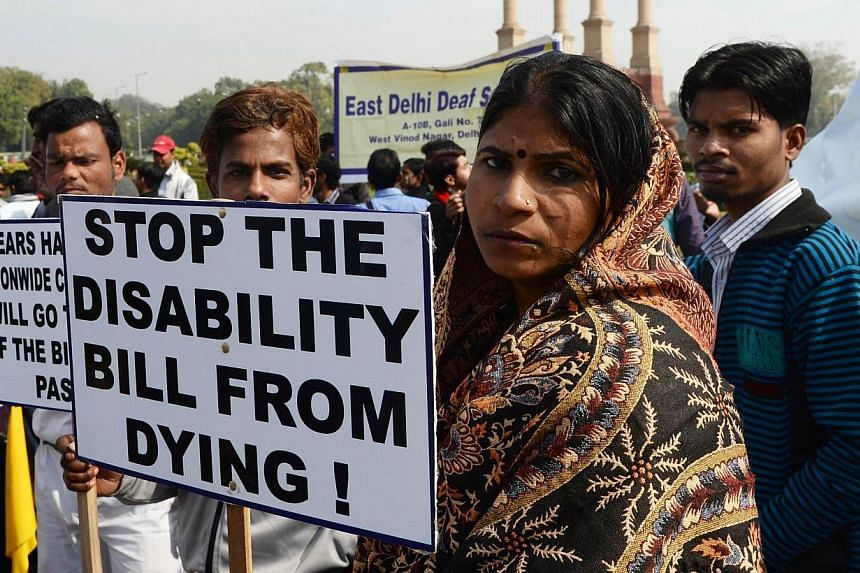 Indian disabled people hold placards as they assemble at India Gate during a protest in New Delhi, on Feb 3, 2014.India's ruling Congress party on Monday, Feb 3, 2014, urged the opposition to allow major bills to be passed in the last session o