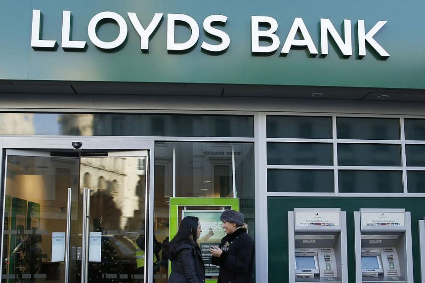 Britain's state-rescued bank Lloyds will take an extra hit of almost 2 billion pounds (S$4.2 billion) to cover mis-selling claims. -- FILE PHOTO: REUTERS