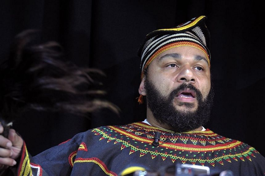 In this picture taken on Jan 11, 2014 controversial French humourist Dieudonne M'bala M'bala holds a fly-swatter as he gives a press conference in the Theatre de la Main d'or in Paris.Controversial French comedian Dieudonne M'bala M'bala has be