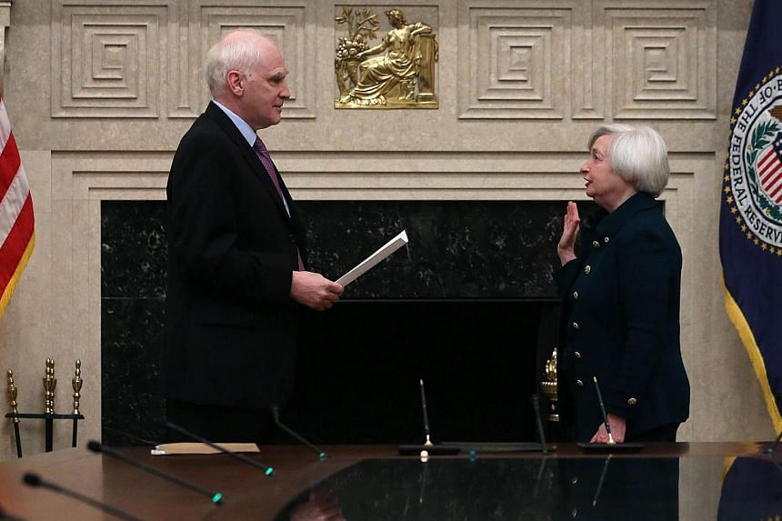Federal Reserve Vice Chairman Janet Yellen (right) is sworn as Federal Reserve Chairman by Federal Reserve Board Governor Daniel Tarullo at the Federal Reserve Building, on Monday, Feb 3, 2013 in Washington, DC.Ms Janet Yellen was sworn in on M