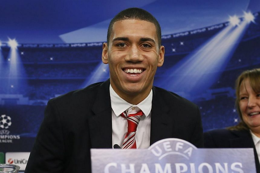 Manchester United's defender Chris Smalling leaves a news conference in Leverkusen, on Nov 26, 2013.Manchester United must win their 14 remaining English Premier League matches to keep alive their hopes of qualifying for the Champions League, a