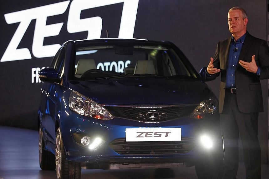 Tim Leverton, Tata Motors' head of research and development, gestures after unveiling Sedan Zest car in New Delhi, on Monday, Feb 3, 2014. India's largest carmaker Tata Motors unveiled its first new models in four years on Monday, banking on two