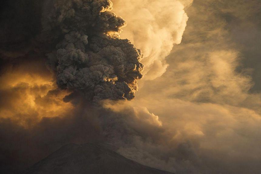 The Tungurahua volcano erupts in Banos, on Feb 1, 2014. -- PHOTO: REUTERS