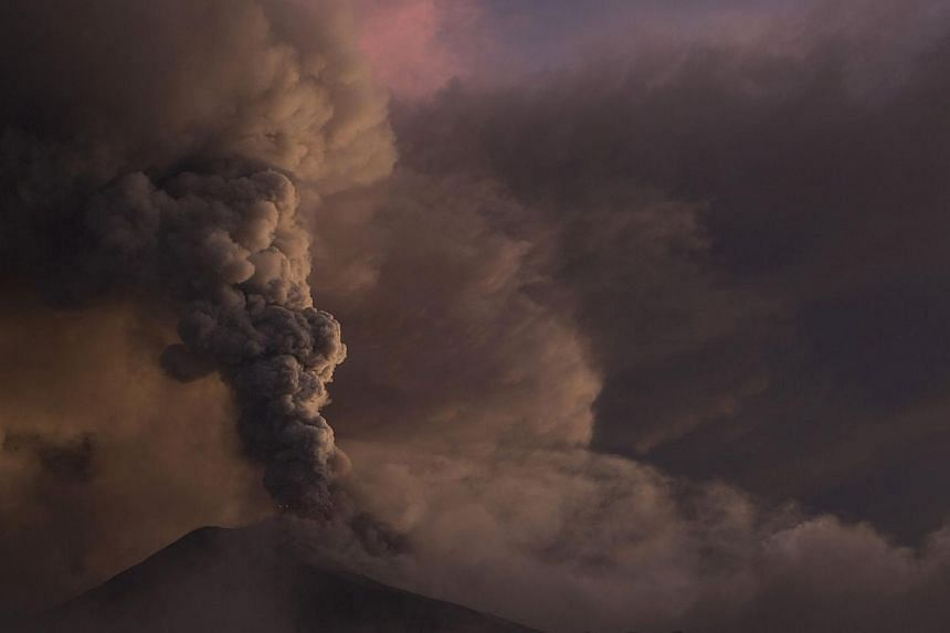 The Tungurahua volcano erupts in Banos, on Feb 1, 2014. The Tungurahua volcano, which has been in an eruption process since 1999, erupted on Saturday, sending ash and pyroclastic material into the atmosphere. -- PHOTO: REUTERS
