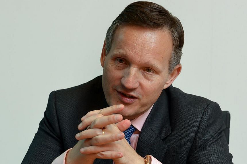 Barclays chief executive Antony Jenkins has turned down his 2013 bonus, saying it would be inappropriate given the bank's hefty bill to pay for past problems and its need to call on investors for cash. -- ST FILE PHOTO:ARTHUR LEE CH