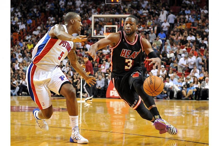 Miami Heat shooting guard Dwyane Wade (3) drives to the basket as Detroit Pistons shooting guard Kentavious Caldwell-Pope (5) defends during the second half at American Airlines Arena.Wade scored 30 points with 10 rebounds and five assists on M