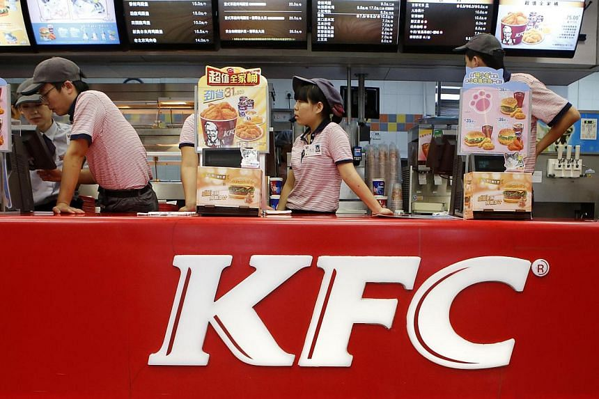 KFC's staff wait for customers at its restaurant in Beijing on Oct 9, 2013.KFC parent Yum Brands Inc on Monday reaffirmed its 2014 profit and said a resurgent bird flu in China had not hurt national sales in its top market. -- FILE PHOTO: REUTE