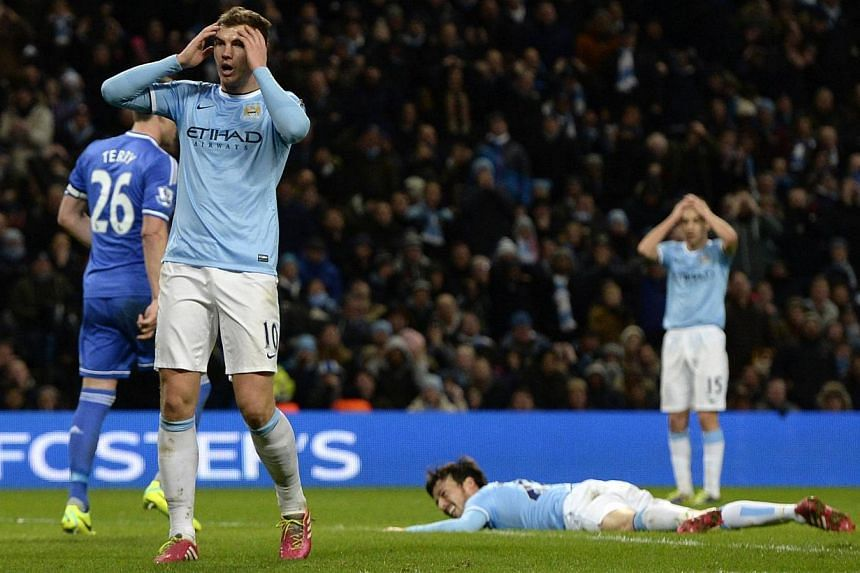 Manchester City's (from left) Edin Dzeko, David Silva and Jesus Navas in agony after a missed opportunity during their English Premier League match against Chelsea at the Etihad Stadium in Manchester on Feb 3, 2014. Chelsea defied Manchester Cit