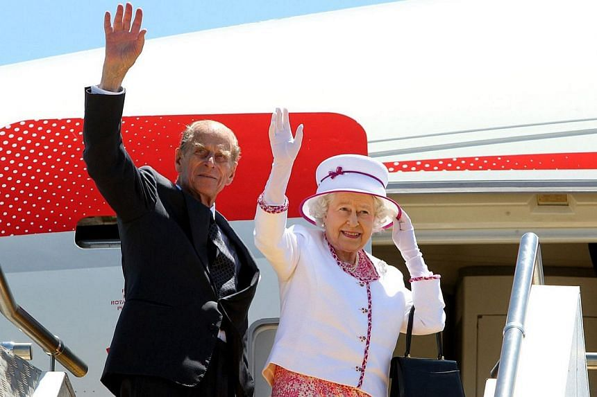 Britain's Queen Elizabeth II (right) and Britain's Prince Philip, Duke of Edinburgh (left), wave goodbye as they board their flight at Perth International Airport following their 10-day visit to Australia  on Oct 29, 2011. Queen Elizabeth I