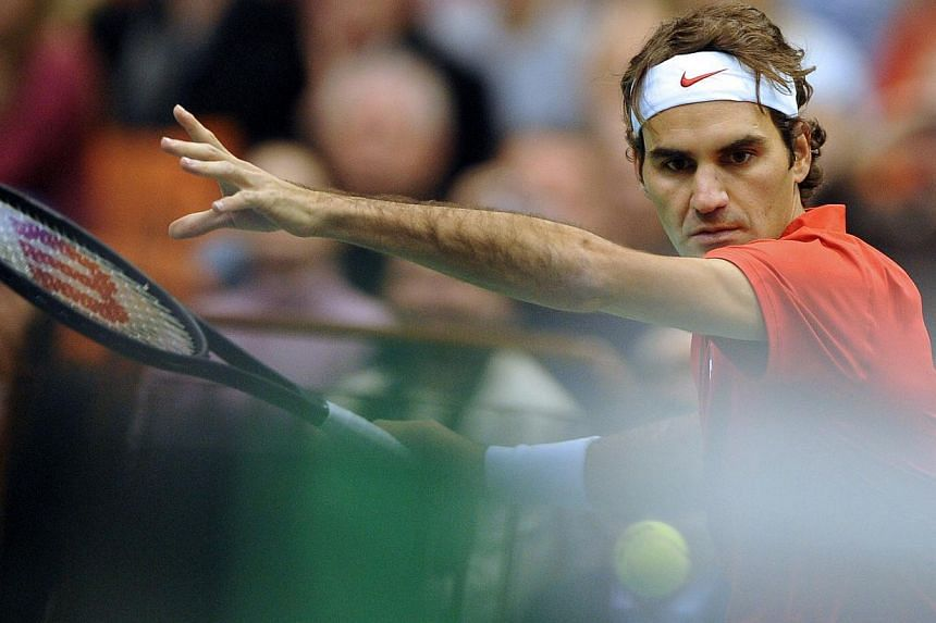 Switzerland's Roger Federer returns the ball to Serbia's Ilija Bozoljac during the Davis Cup World Group first round tie between Serbia and Switzerland in Novi Sad on Jan 31, 2014.Former tennis men's world number one Roger Federer tweeted on Mo