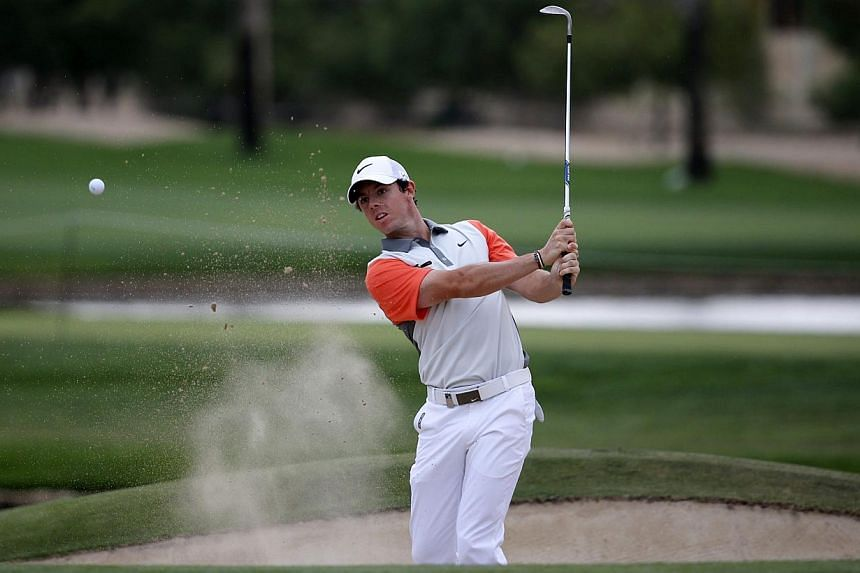 Rory McIlroy of Northern Ireland hits the ball out of the bunker on the 13th hole during the final round of the 2014 Omega Dubai Desert Classic in Dubai on Feb 2, 2014. One of Rory McIlroy's lowest points during a frustrating 2013 campaign came at th
