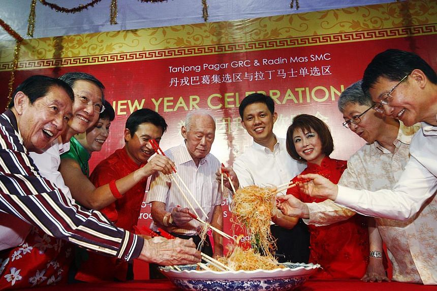 Mr Lee Kuan Yew (fifth from left) tossing the traditional yu sheng at a Chinese New Year dinner for Tanjong Pagar GRC held at Queenstown Primary School on Feb 3, 2012. Mr Lee will not be attending the annual Tanjong Pagar constituency Chinese New Yea