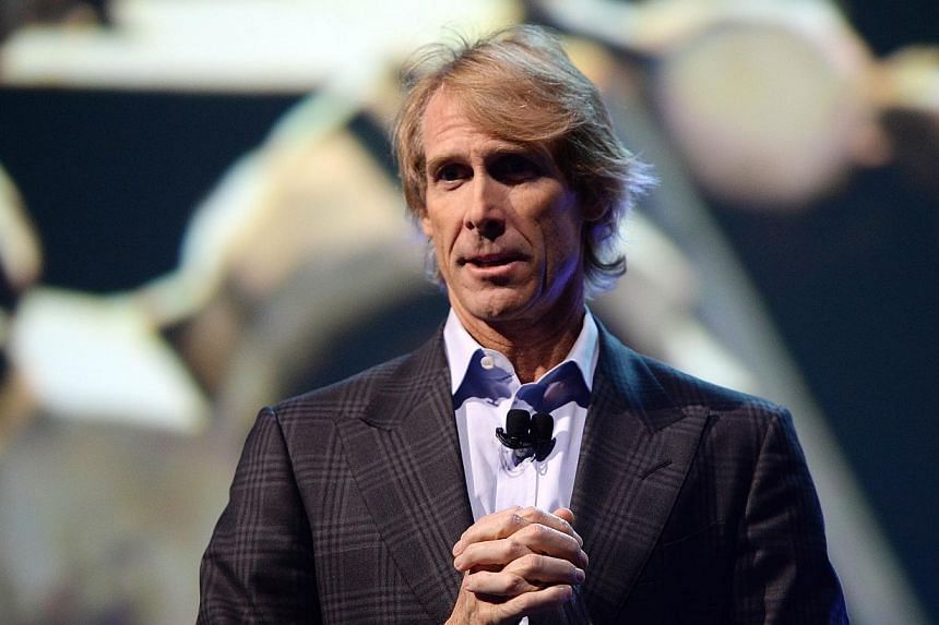 Movie director Michael Bay speaks at the Samsung press event at the Mandalay Bay Convention Center for the 2014 International CES, on Jan 6, 2014 in Las Vegas, Nevada. Two brothers charged with trying to extort nearly S$16,500 from Hollywood director